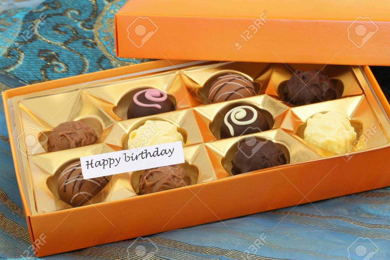 Happy Birthday Card With Box Of Assorted Chocolates Pralines And Truffles Stock Photo