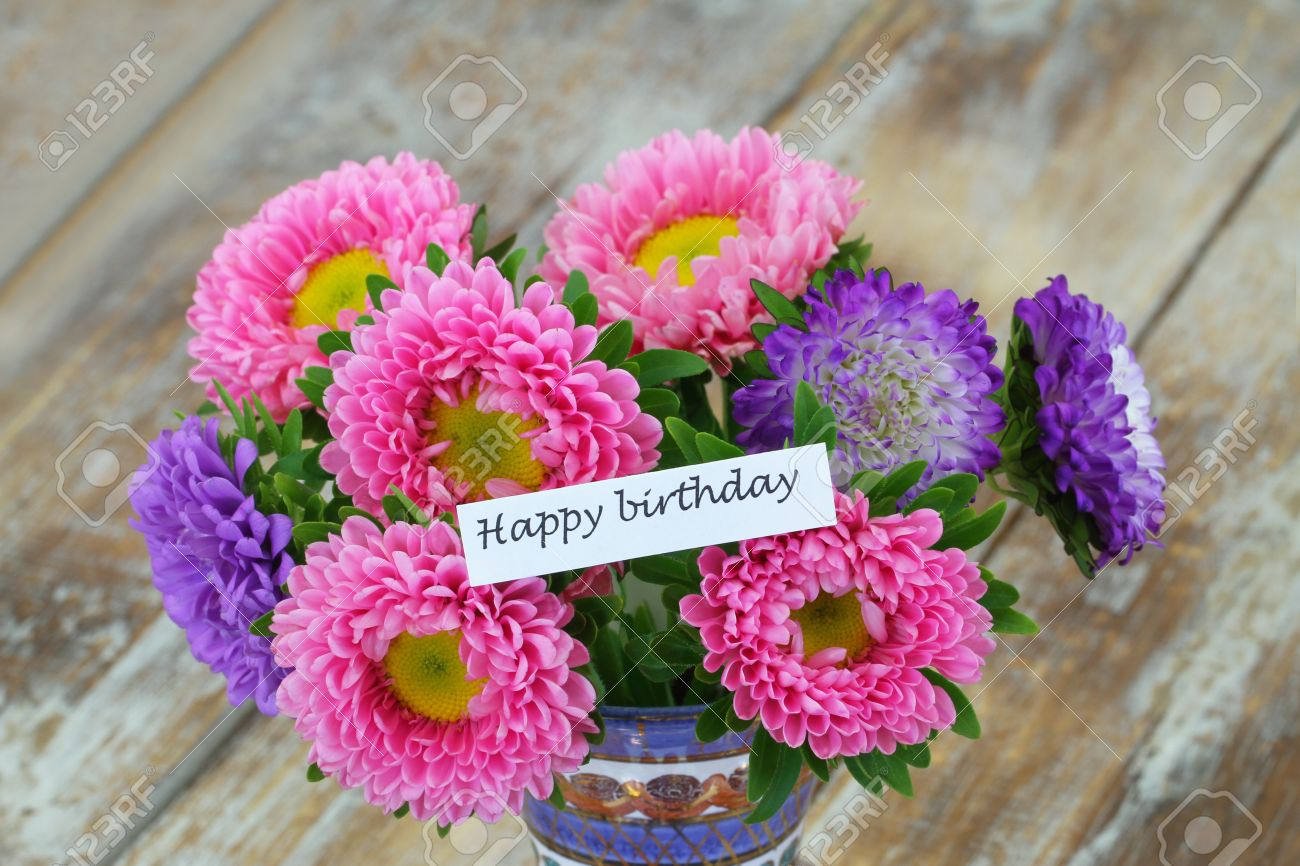 Happy birthday card with colorful aster flower bouquet on rustic happy birthday card with colorful aster flower bouquet on rustic wooden surface stock photo 61250672 izmirmasajfo