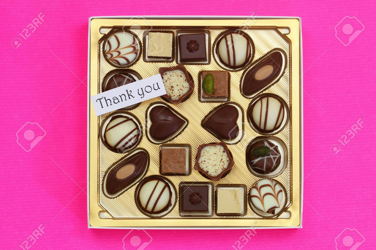 thank you card with box of assorted chocolates on pink background