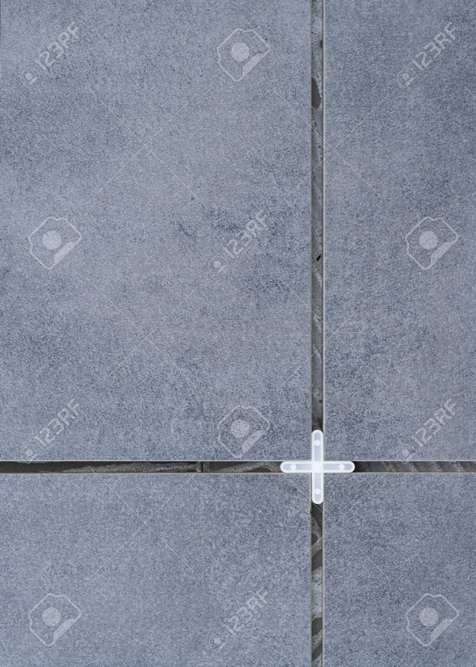 Tiles and Plastic Spacer Stock Photo - 2190380