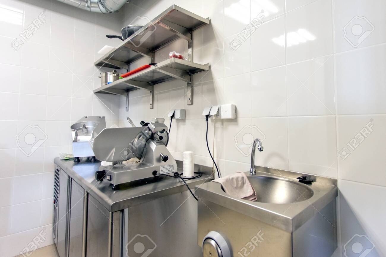 The Interior Of A Small Kitchen In A Restaurant With Shiny Metal Stock Photo Picture And Royalty Free Image Image 118906290