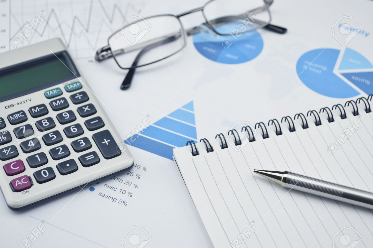 Pen Book Glasses And Calculator On Financial Chart And Graph ...
