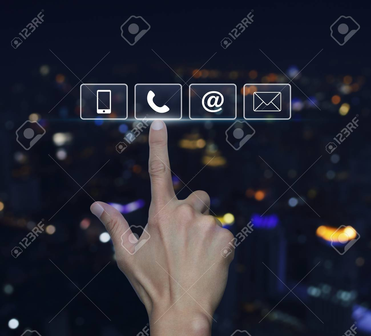 Background image email support - Hand Pressing Telephone Mobile Phone At And Email Buttons Over Blurred Light City Tower