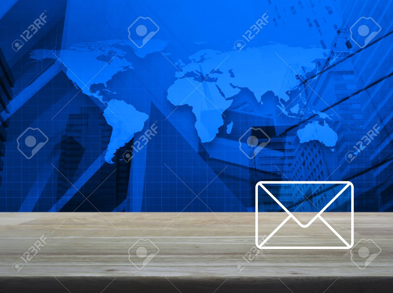 Mail icon on wooden table over world map and modern city tower mail icon on wooden table over world map and modern city tower contact us concept gumiabroncs Images