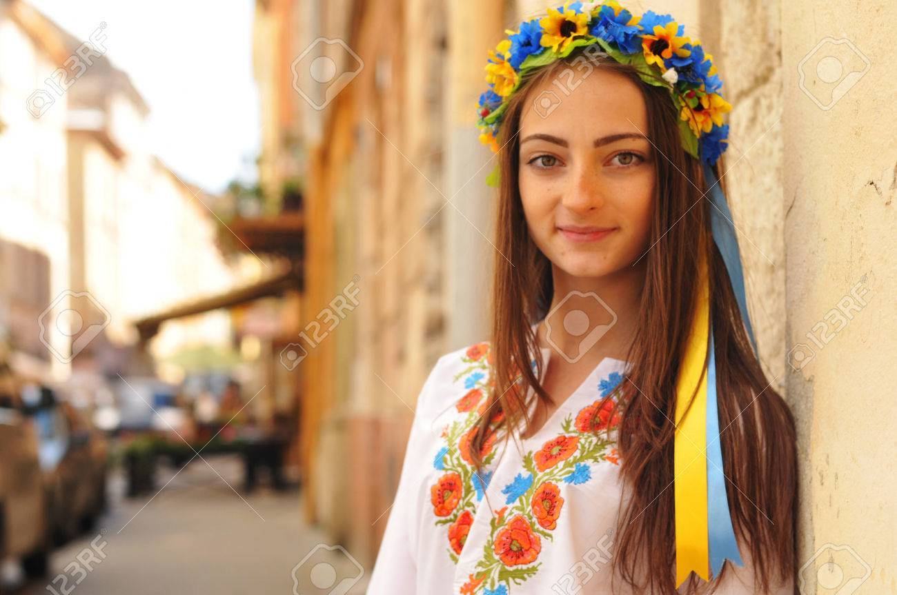 Pretty ukrainian girl stands and looking at camera she is wearing pretty ukrainian girl stands and looking at camera she is wearing national clother with poppy dhlflorist Gallery