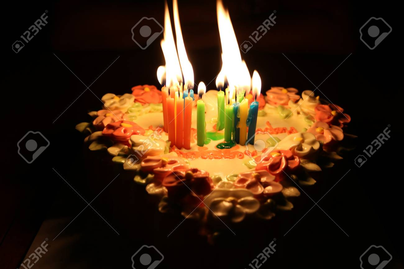 Candle Flame Light On Cake At Night Stock Photo