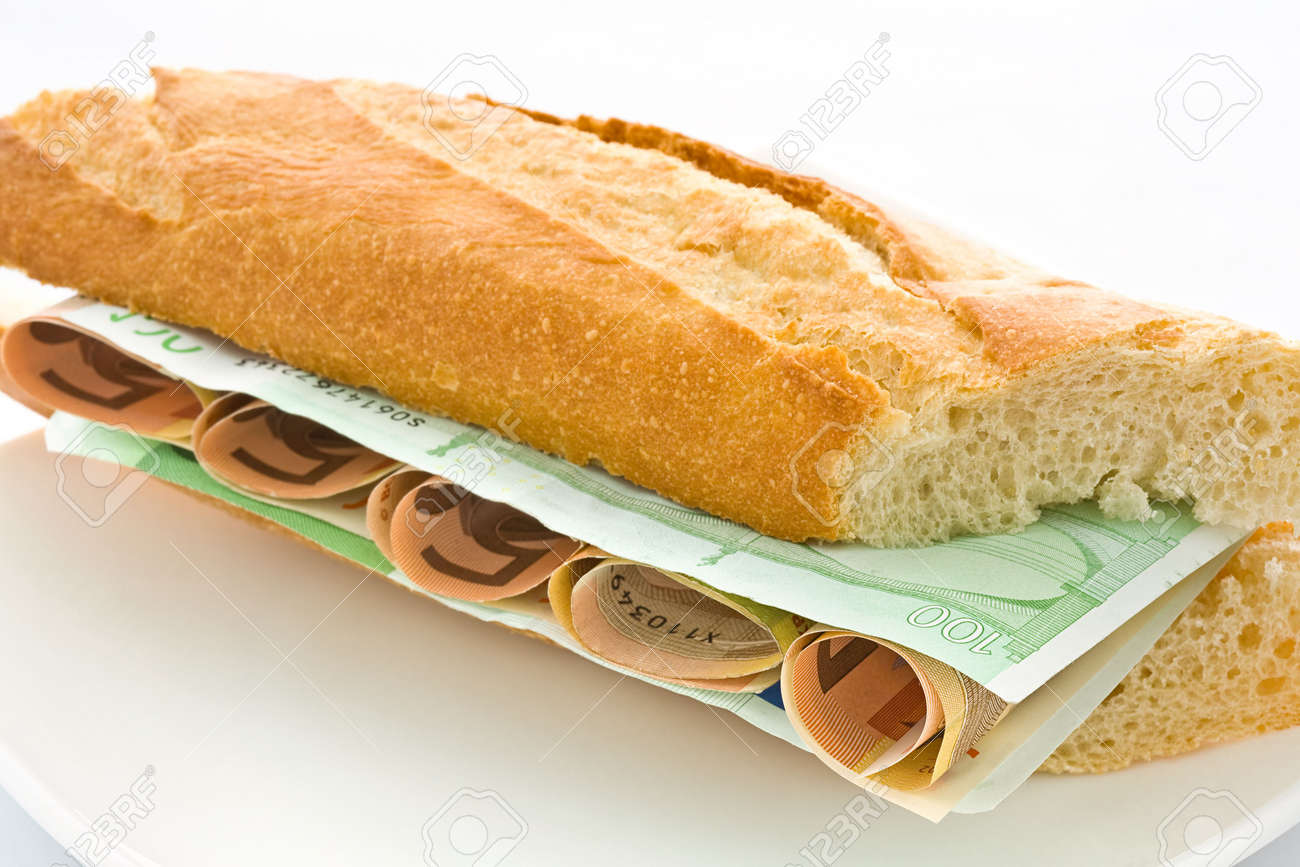 Fresh white loaf with a layer of monetary denominations inside Stock Photo - 3243873