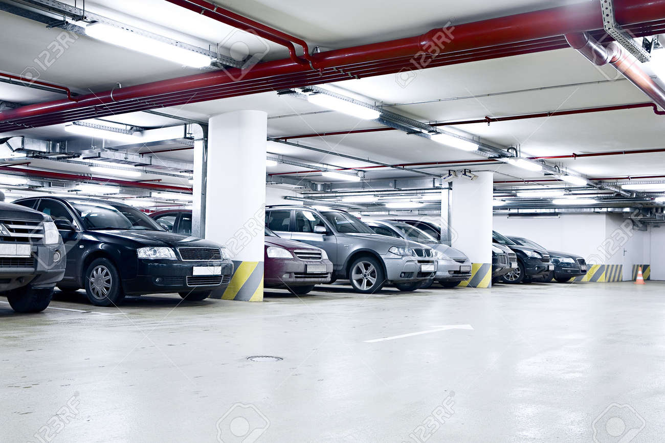 the shined underground garage with the moving cars and parked the shined underground garage with the moving cars and parked cars stock photo 4210393