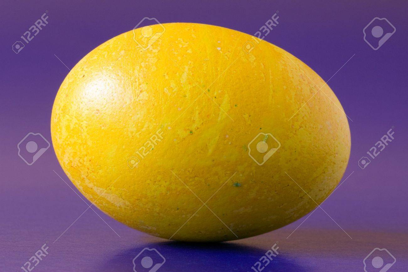 yellow  easter egg, isolated on purple background Stock Photo - 6746967