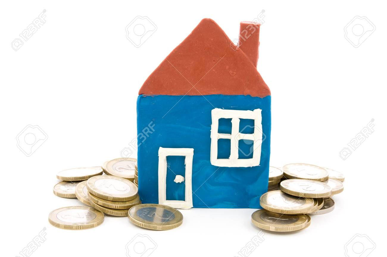 mortgaging concept. house and coins over a white background. Stock Photo - 9560795