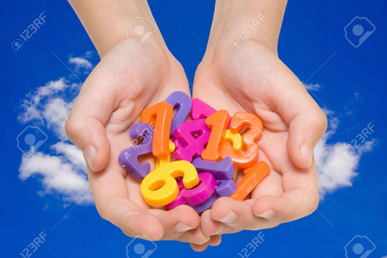 child hands with color numbers on sky background. Stock Photo - 9857118