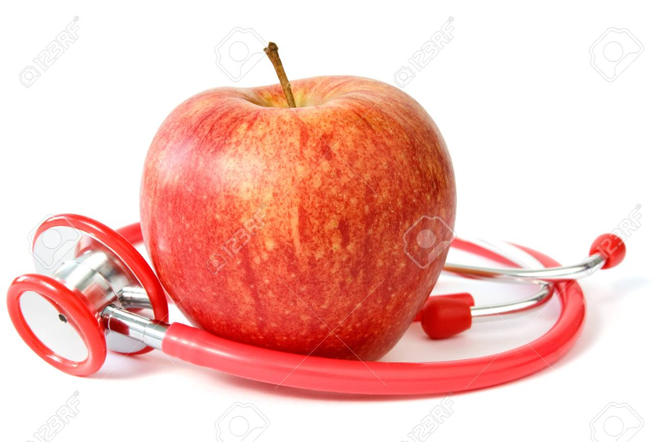 red apple and stethoscope over a white background Stock Photo - 12407775