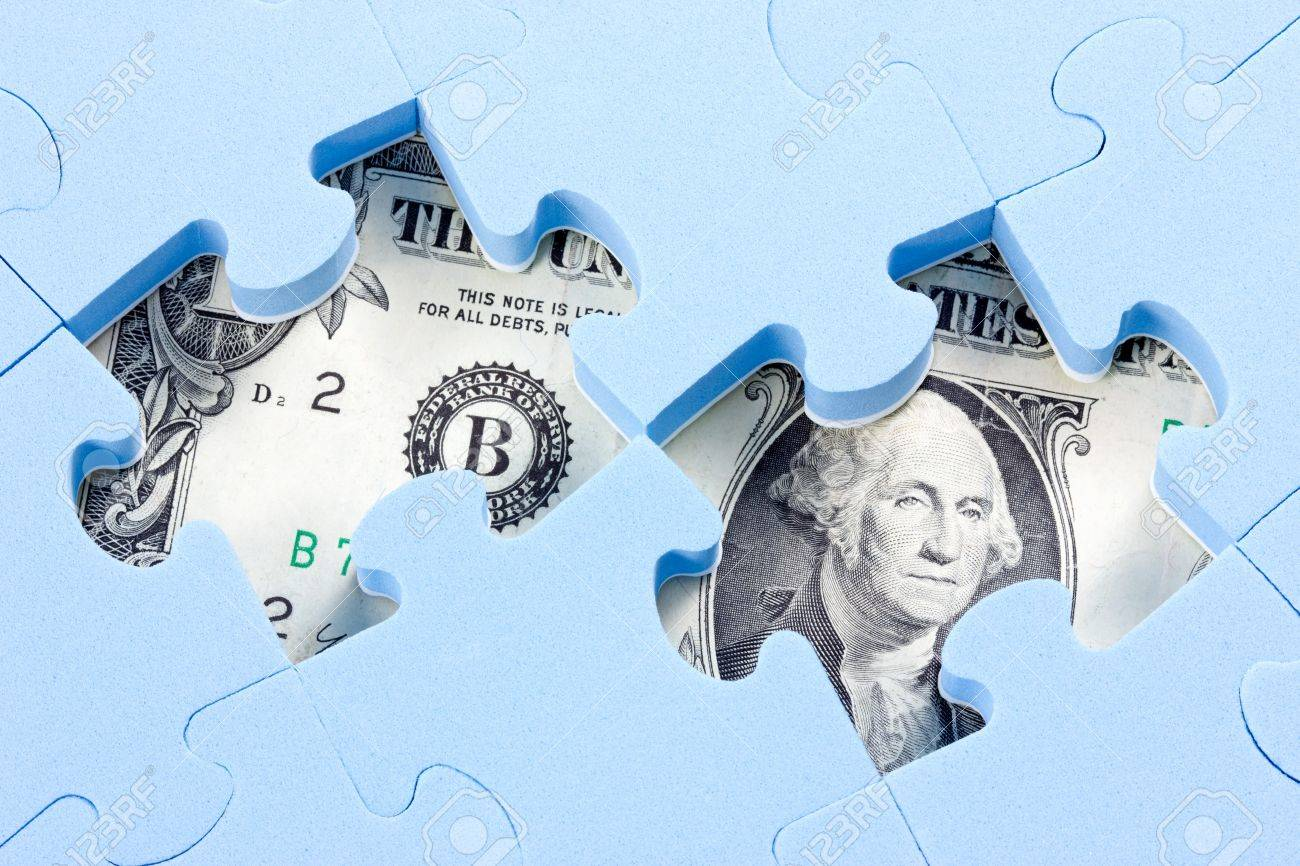 Hidden assets concept. Blue puzzle on one dollar bill Stock Photo - 13385323