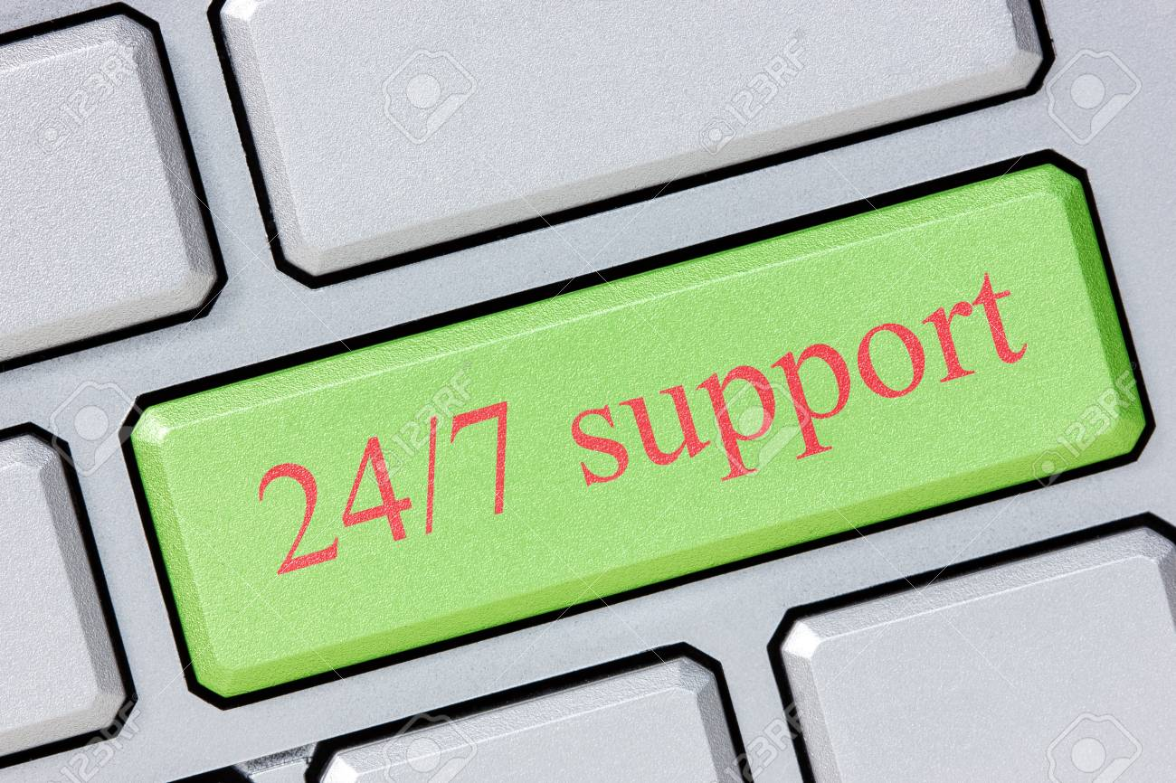 Keyboard with green 24/7 support button, business concept Stock Photo - 17587148