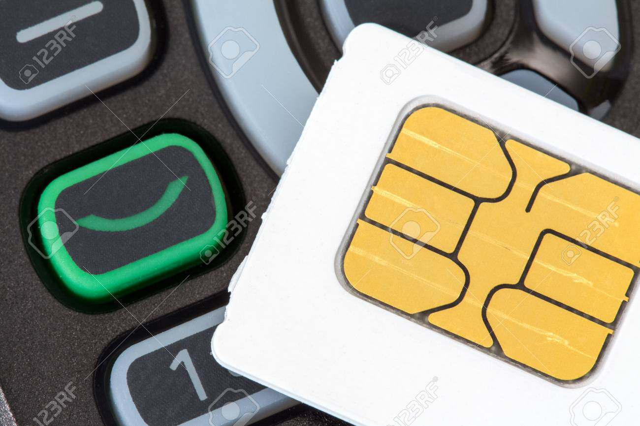 Close up of cellular phone and sim card