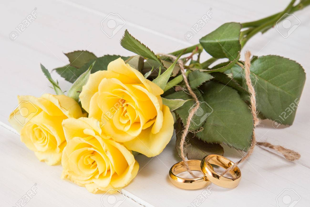 Stock Photo Yellow Roses And Wedding Rings Tied With String: Yellow Roses Wedding Rings At Reisefeber.org