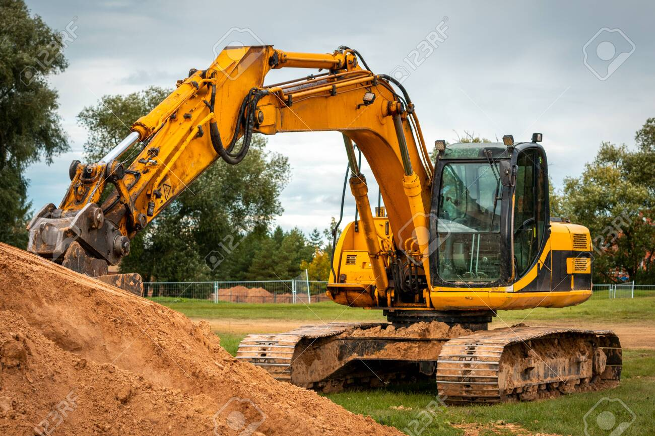 Excavator during earthmoving at construction site. Ð¡onstruction machinery for excavation. - 154756065