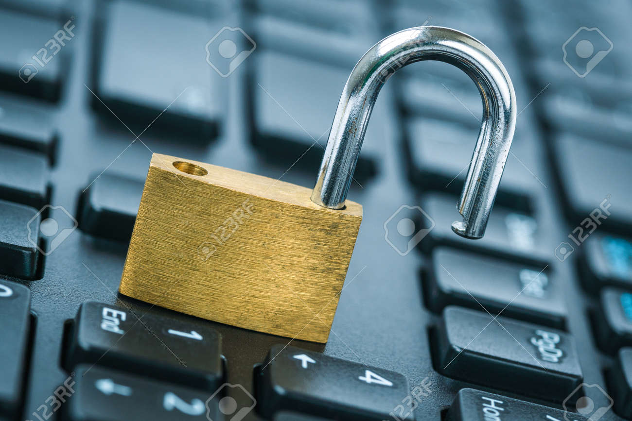 Computer security concept. Unlocked padlock on laptop keyboard. Open security lock on computer keyboard - computer security breach concept. - 156793181