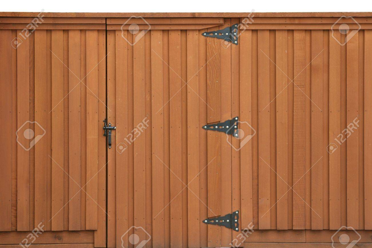 Closed gate in a wooden fence Stock Photo - 10314301