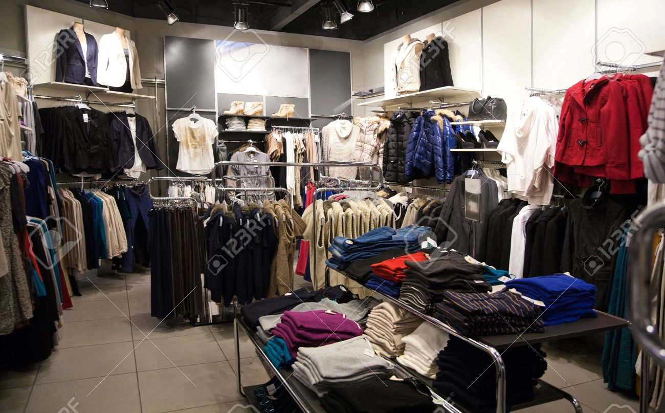 shelves with clothes in the store stock photo picture and royalty rh 123rf com clothing store racks and shelves cheap clothing store shelves