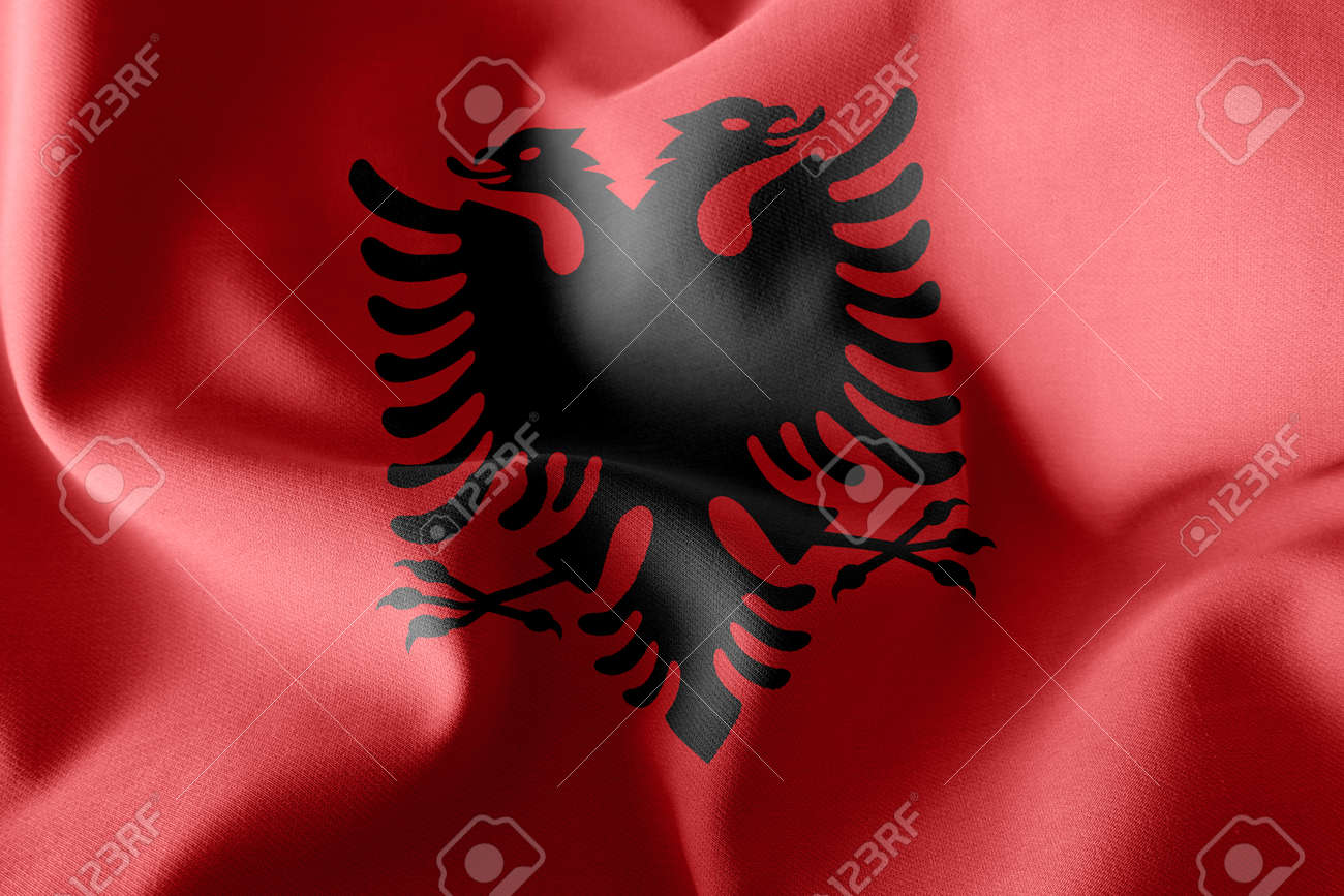 3D illustration flag of Albania. Waving on the wind flag textile background - 168929074