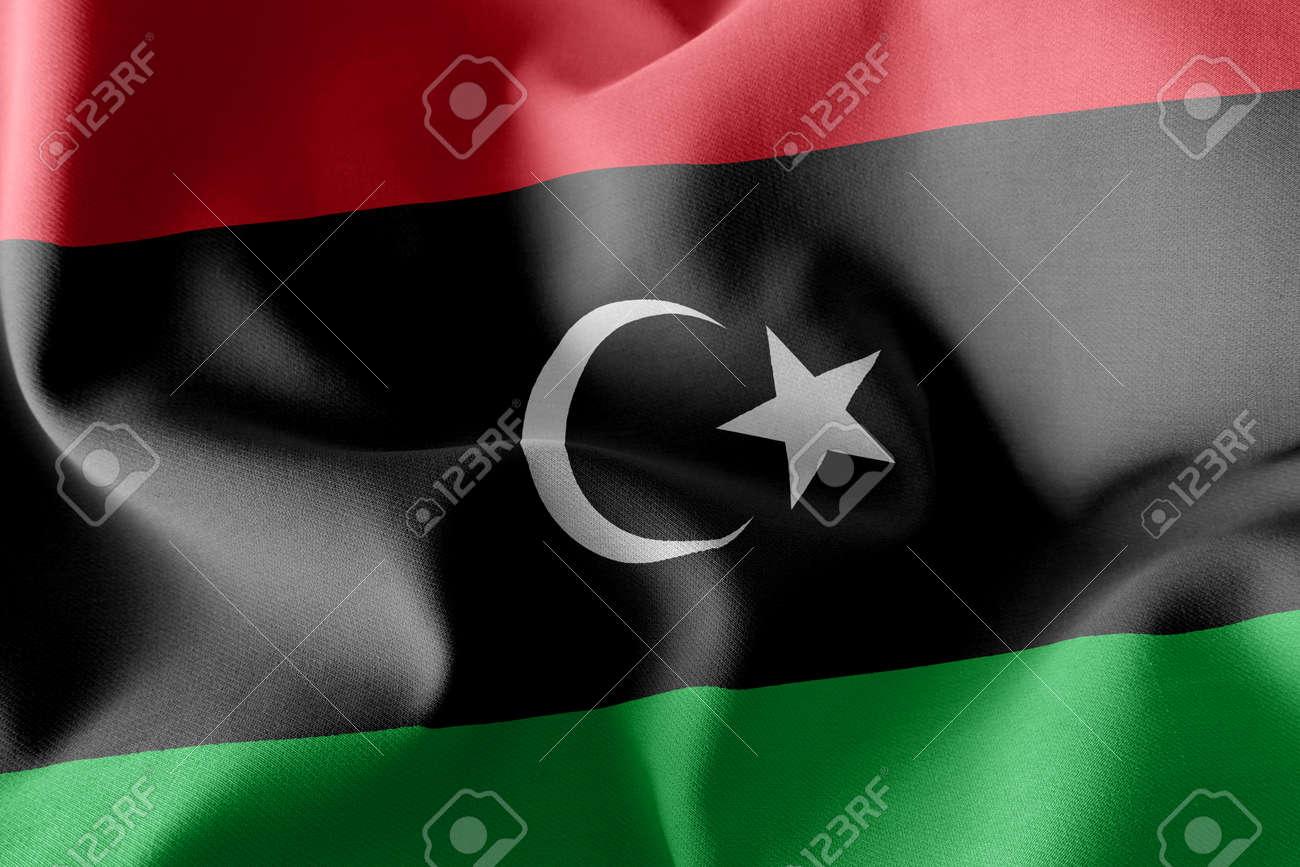 3D illustration flag of Libya. Waving on the wind flag textile background - 168929095