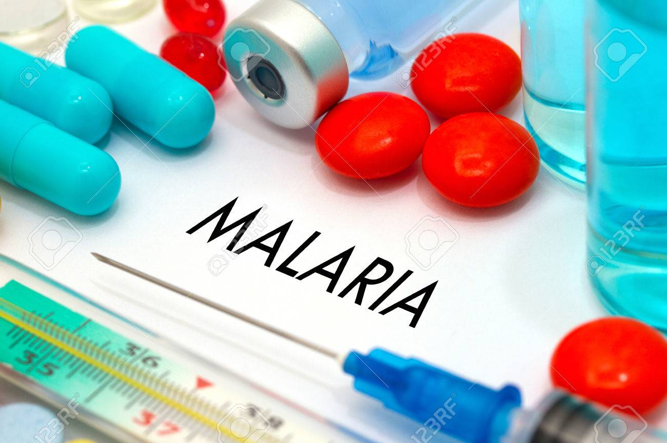 Malaria. Treatment and prevention of disease. Syringe and vaccine. Medical concept. Selective focus - 60785323
