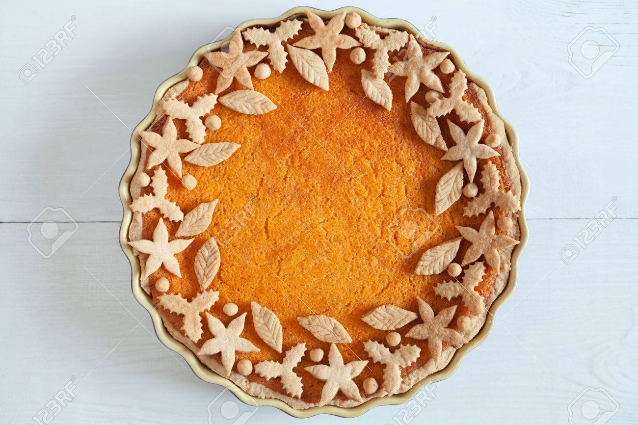 Homemade Delicious Pumpkin Tart Pie With Decorations On Top