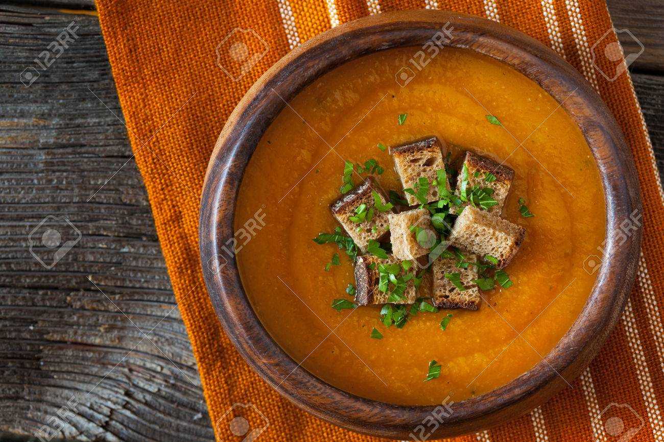 Natural vegetarian pumpkin cream soup with croutons delicious natural vegetarian pumpkin cream soup with croutons delicious organic food recipe traditional halloween or thanksgiving forumfinder Images