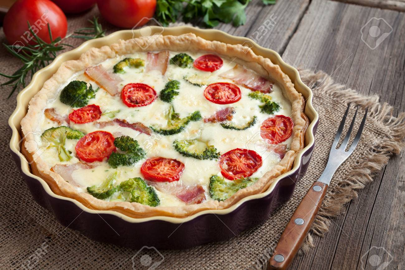 Quiche lorraine traditional homemade french food preparation stock quiche lorraine traditional homemade french food preparation recipe with bacon broccoli cheese and tomatoes forumfinder Images