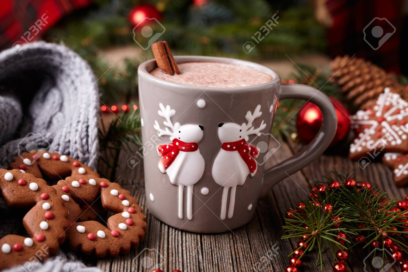 Cup Of Hot Chocolate Or Cocoa Beverage With Two Cute Deer Cinnamon