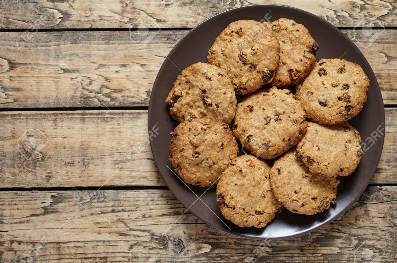 Homemade cereal oatmeal cookies with raisins and chocolate healthy homemade cereal oatmeal cookies with raisins and chocolate healthy sweet dessert snack food on vintage wooden ccuart Choice Image