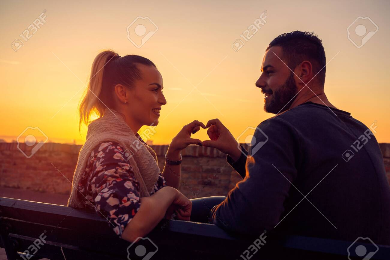 Heart and love.Happy Couple in Love at evening enjoying time together. - 133124264