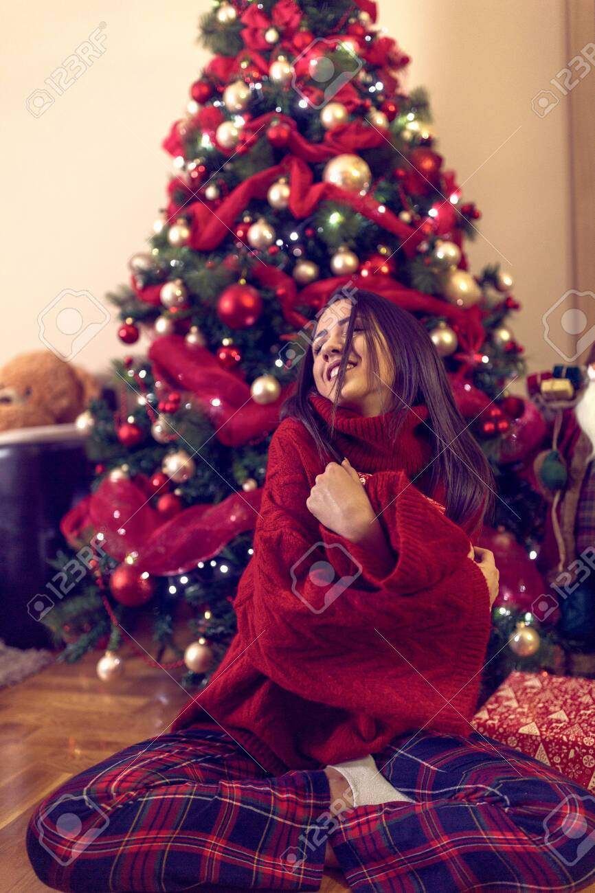 Happy young woman and Christmas gifts on floor at home.Christmas holiday - 133124265