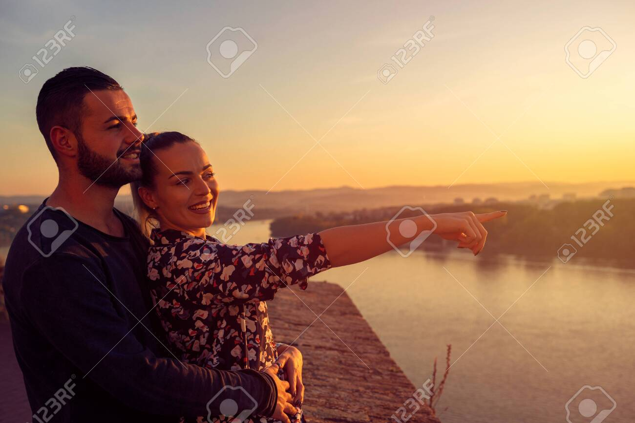 loving man and woman watching the sunset - 133124267