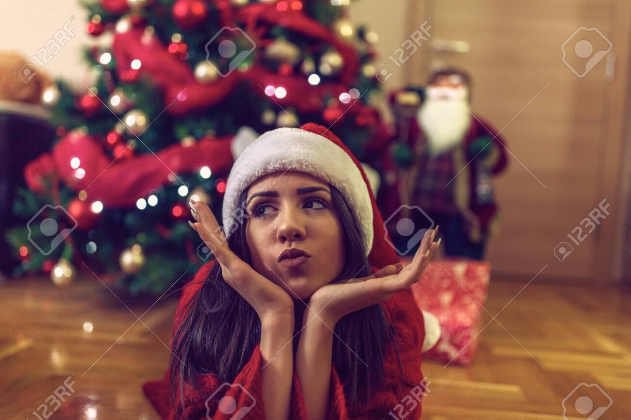 Happy funny girl Santa hats on Christmas celebrating Christmas at home - 133124281