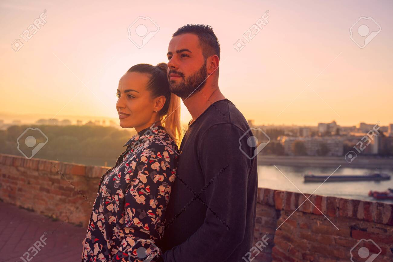 Young romantic couple enjoys at the sunset - 134962246