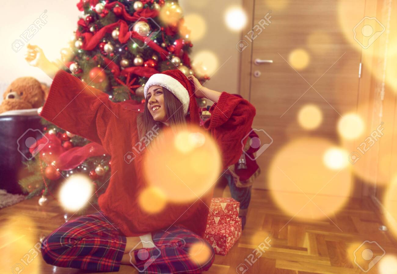 Happy Christmas! Happy Woman having fun celebrating Christmas - 134962665