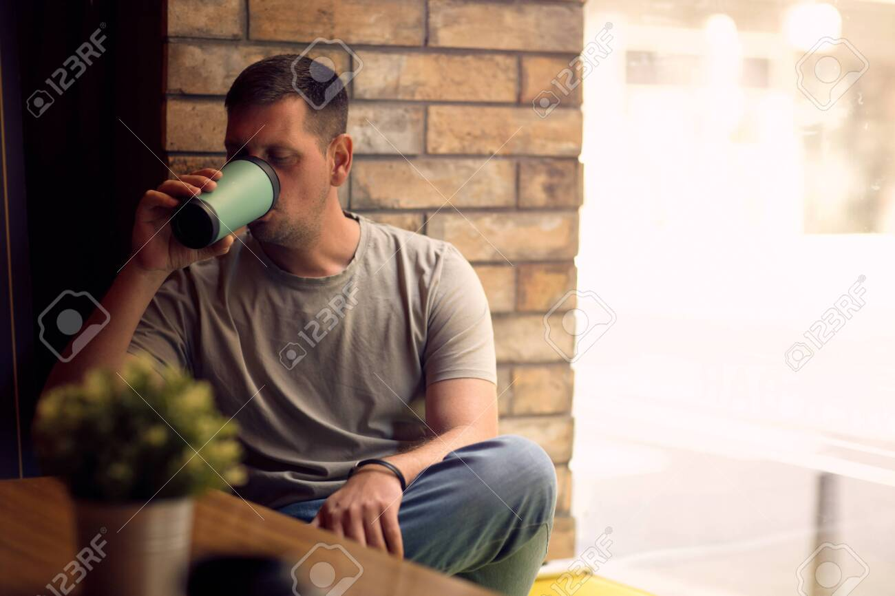 young man in restaurant.Man drinking coffee in cafe - 134962570