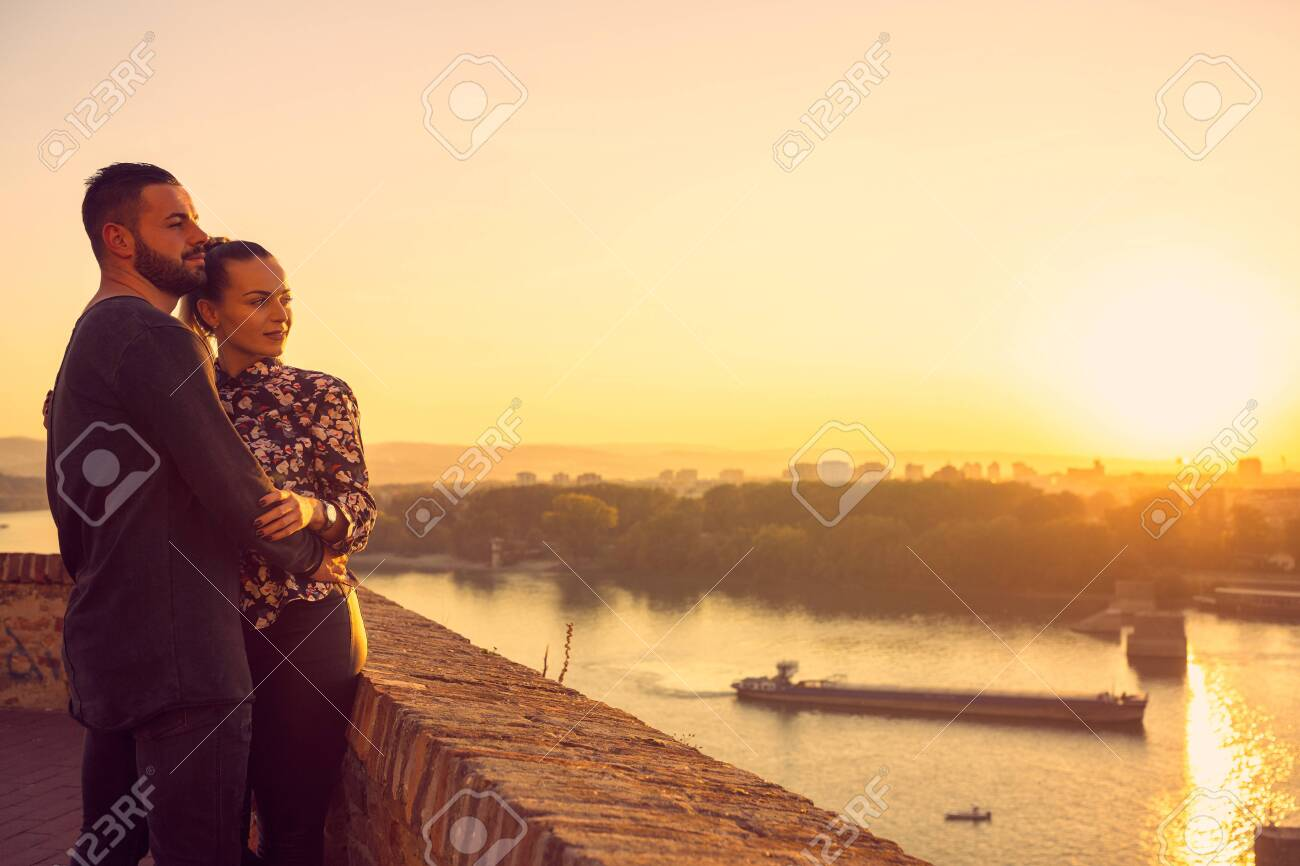 Romantic young couple in love at sunset - 134962572