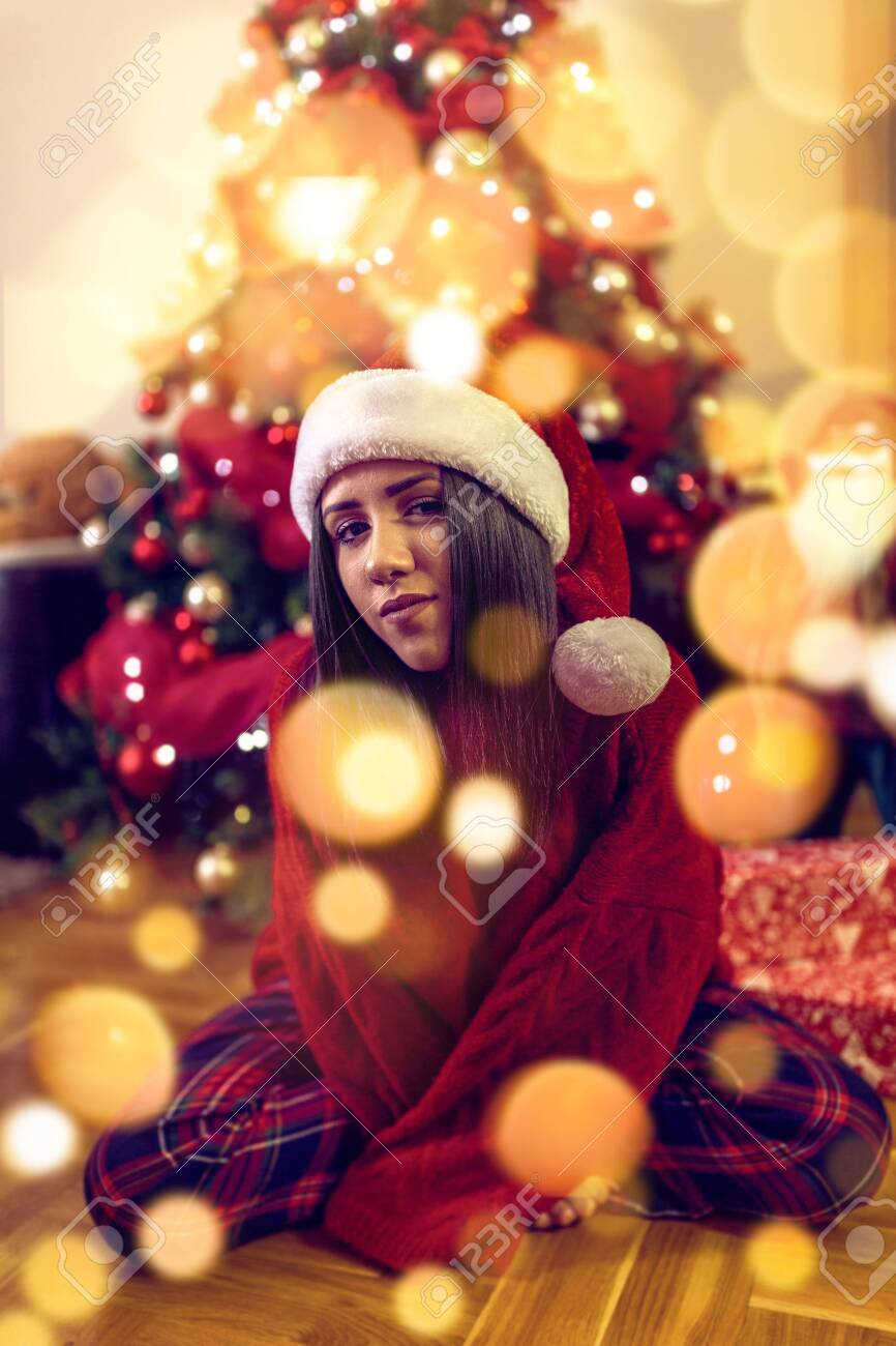 Happy Christmas! Happy girl having fun celebrating Christmas - 134962579