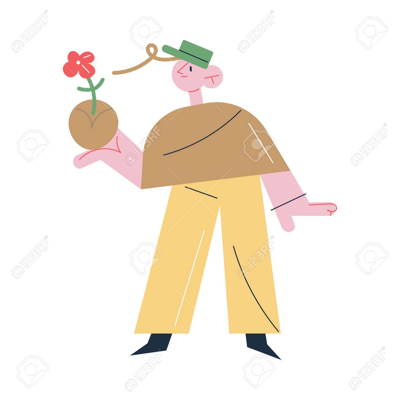 Man gardener standing and holding flower in soil in hand during gardening - 164873980
