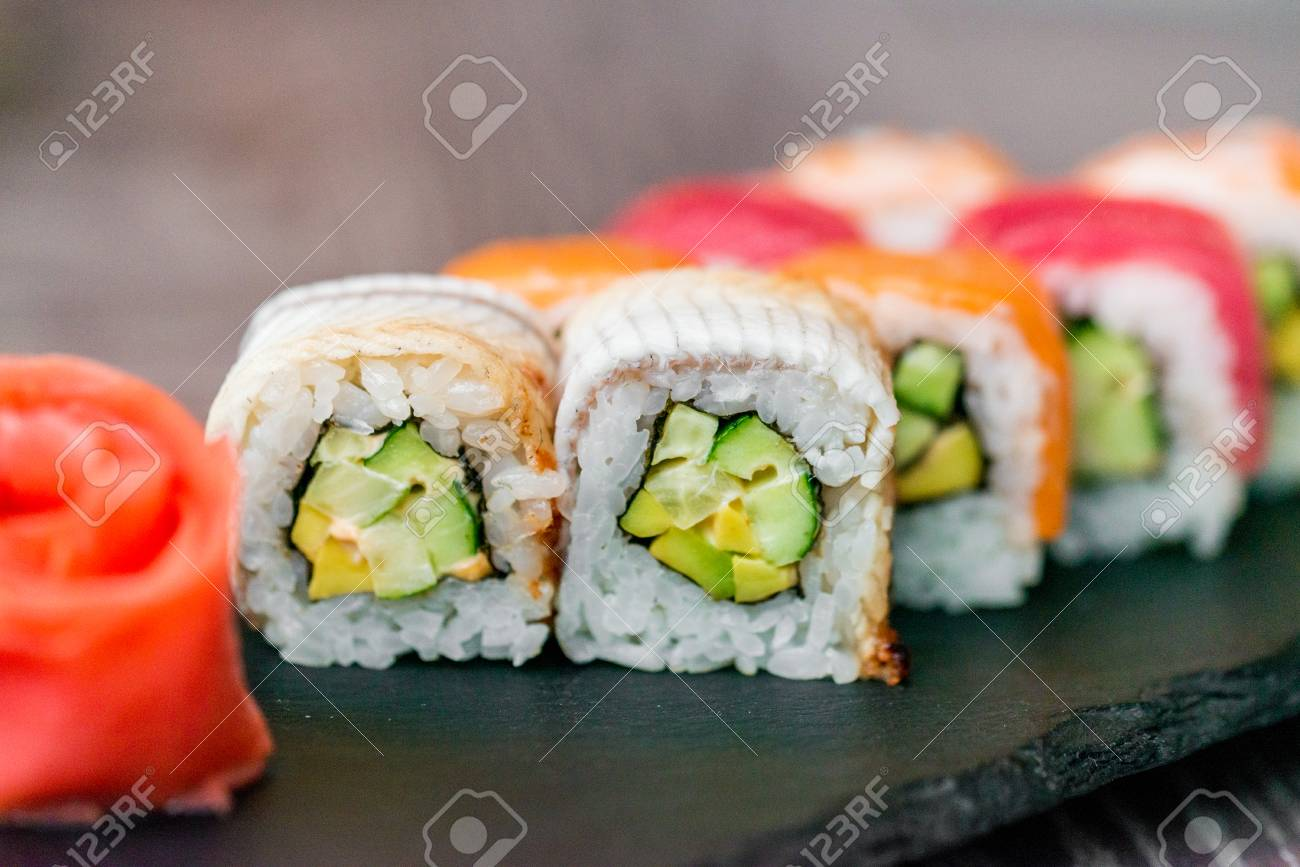 Rainbow Sushi Roll On Tray With Ginger Close Up Stock Photo Picture