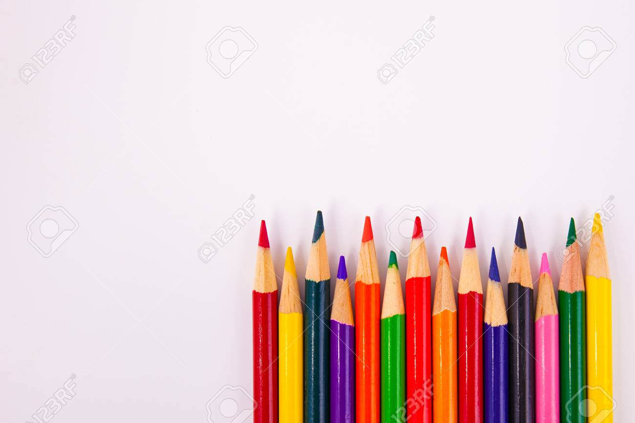 Art coloring shading pencils in a row framed lower right background