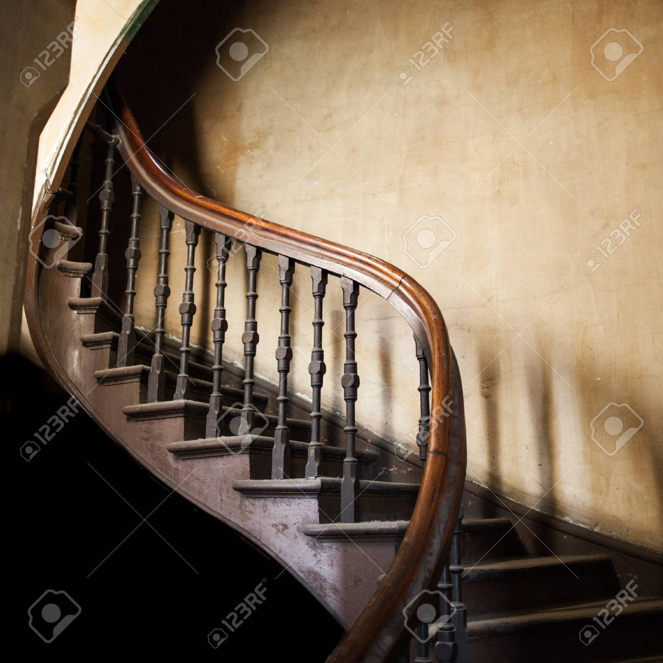 Stock Photo   Vintage Wooden Winding Staircase Going Up With Copy Space On  Old Decaying Wall