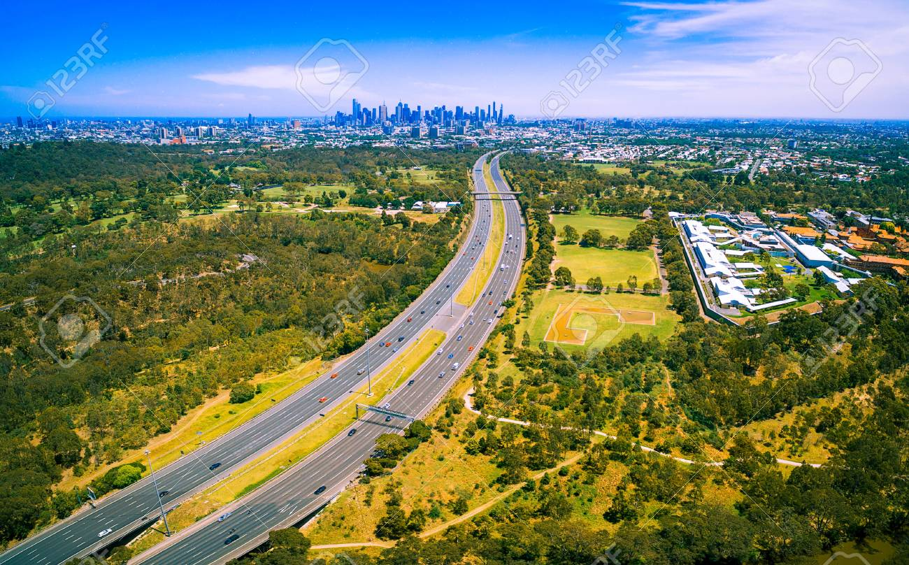 Aerial panorama of green parkland, Melbourne Polytechnic, and
