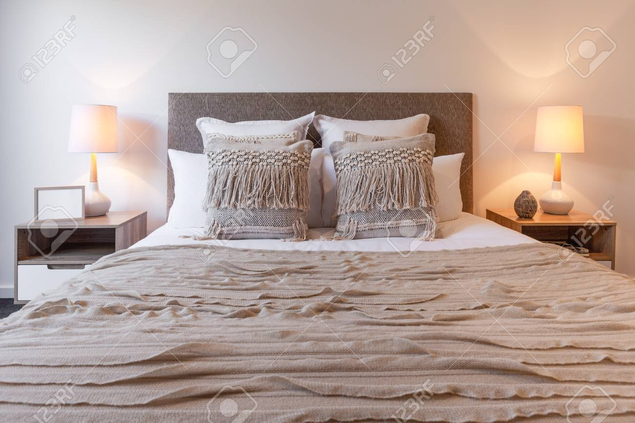 Decorative Pillows On Bed Arrangement With Bedroom Lamps And Stock Photo Picture And Royalty Free Image Image 103352867
