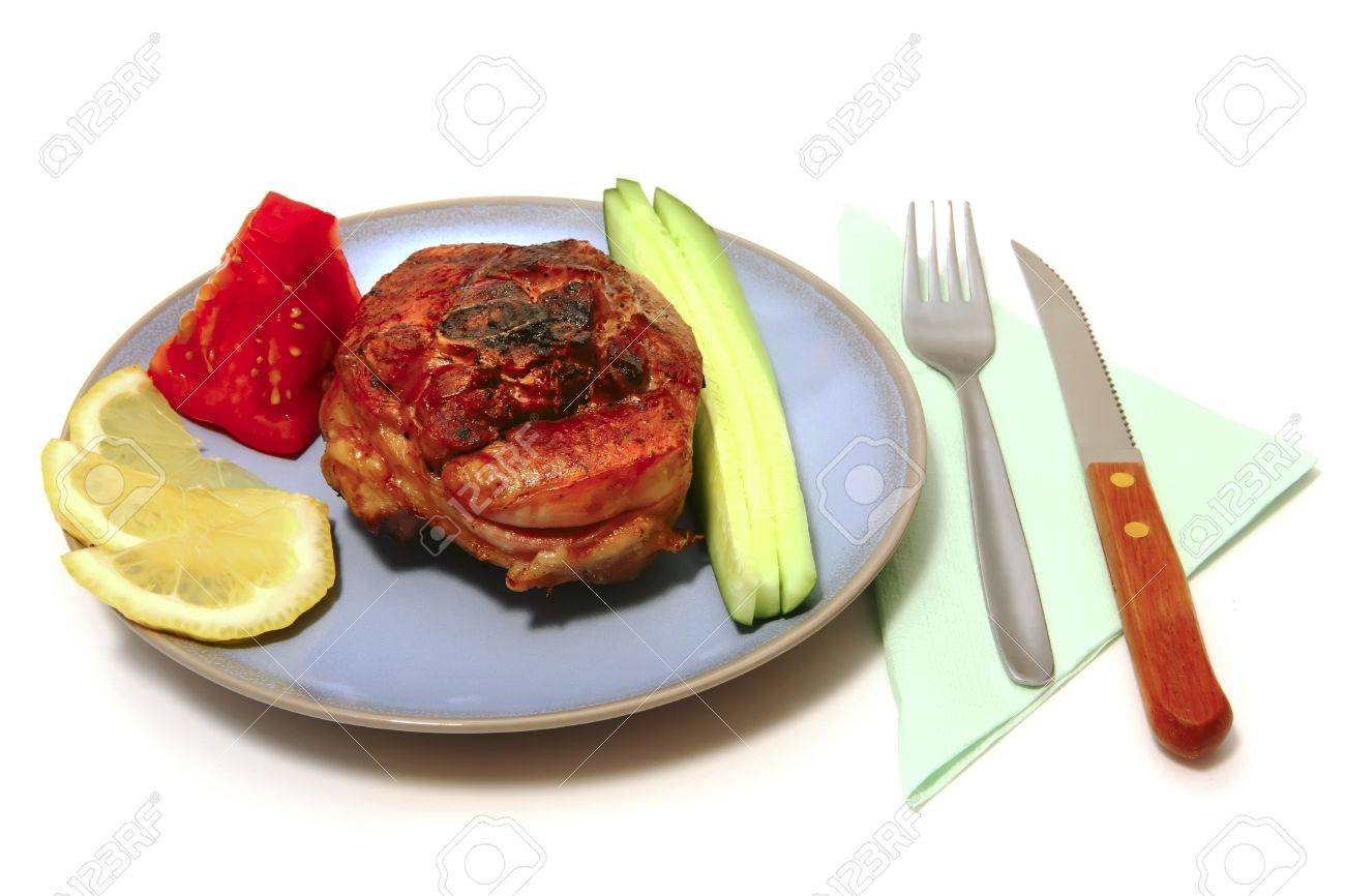 served roasted turkey leg cut and vegetables with utensil Stock Photo - 5056868