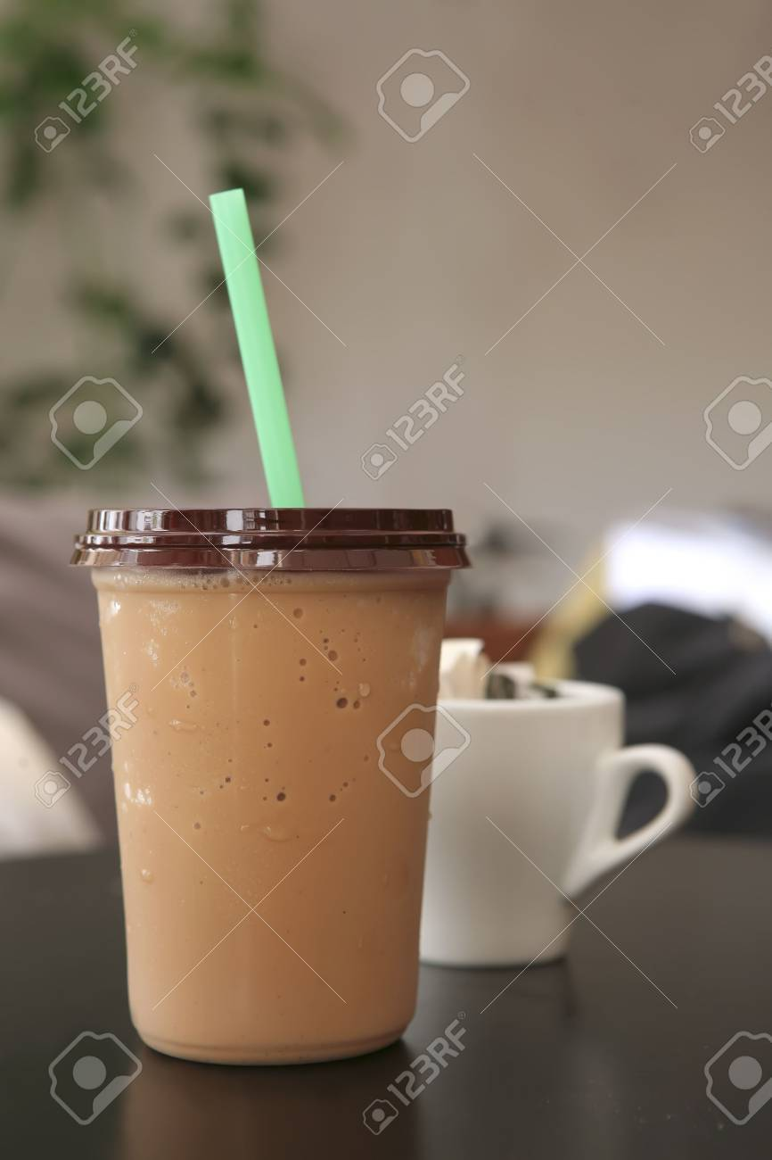 ice coffee with cappuccino on black table Stock Photo - 5113384