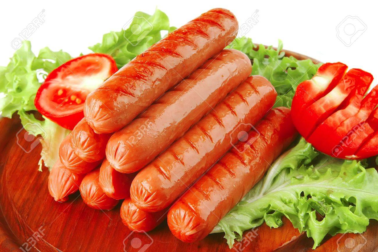 served grilled beef red sausages on wooden plate - 6140504